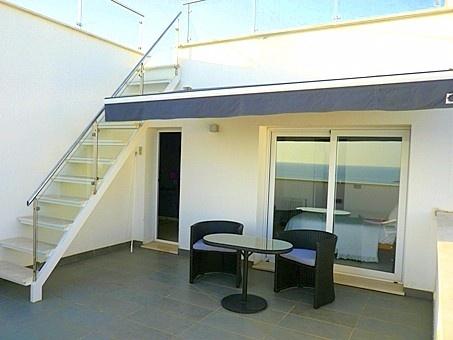 Terraza privada con acceso a la azotea